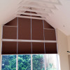 Cellular pleated gable end electric blinds.
