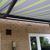 Markilux 1710 awning in anthracite finish installed in Needham Market, Suffolk.